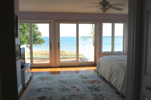 The Aquebogue beach house master bedroom with panoramic views of the Peconic Bay