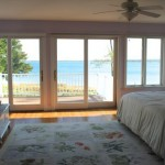 view out french doors, overlooking beach