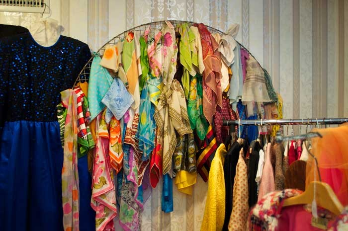 Colorful scarves brighten up the vintage clothing sections toward the back of the store.